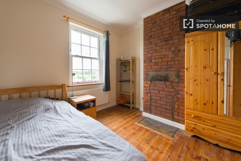 Bedroom 1, couple-friendly with double bed and desk