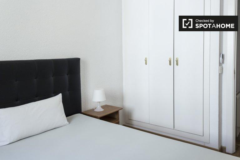 Chambre confortable dans un appartement partagé à Chamberí, Madrid
