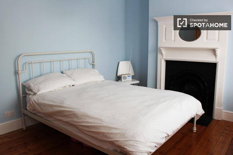 Bedroom 2 with double bed and fireplace