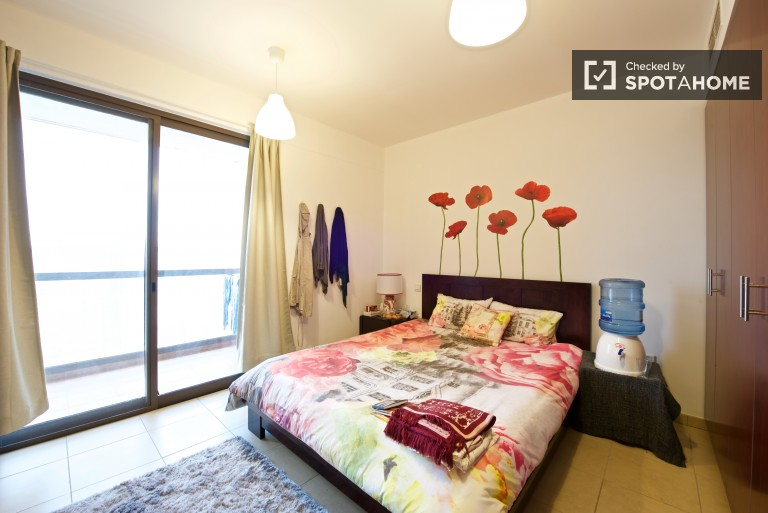 Bedroom 3, couple-friendly with queen-size bed and balcony