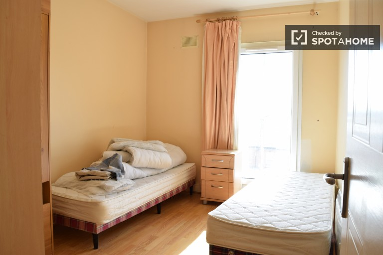 Bedroom 1 - a shared-occupancy room with 2 single beds for rent