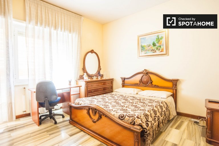 Double Bed in Rooms with private bathrooms for rent in 2-bedroom apartment with balcony in Talenti