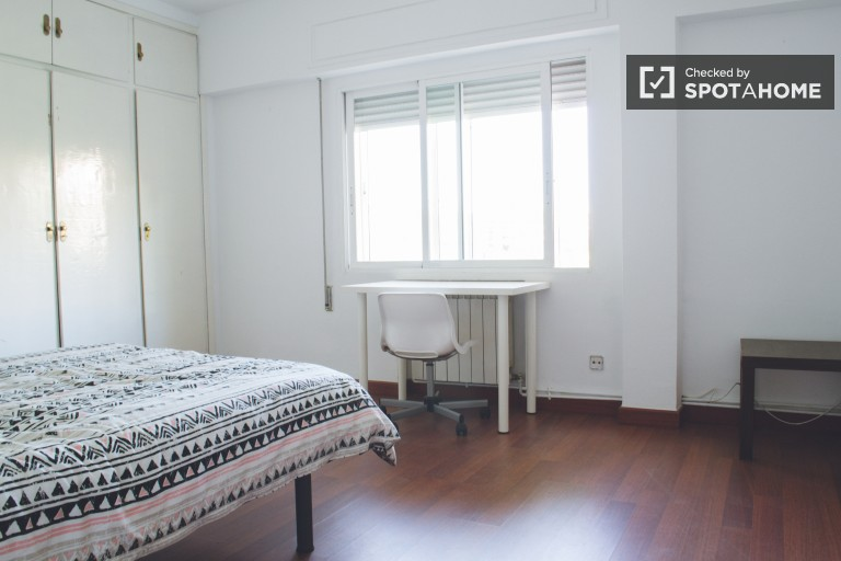Bedroom 3 with double bed and street view