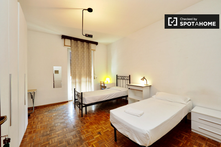 Twin Beds in Rooms for couples and singles in a huge 6 bedroom apartment