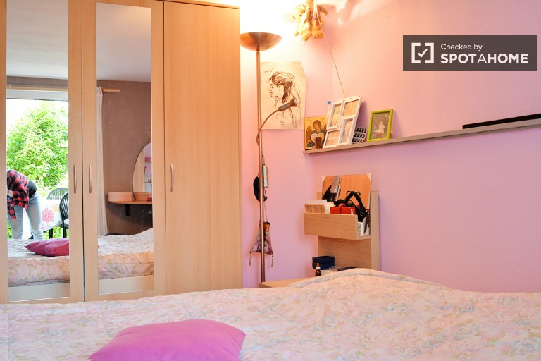 Bedroom 1 with double bed and terrace access
