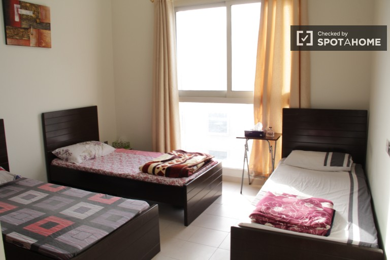 Single Bed in Rooms for rent in 3-bedroom apartment with pool access, AC and a gym in Al Barsha