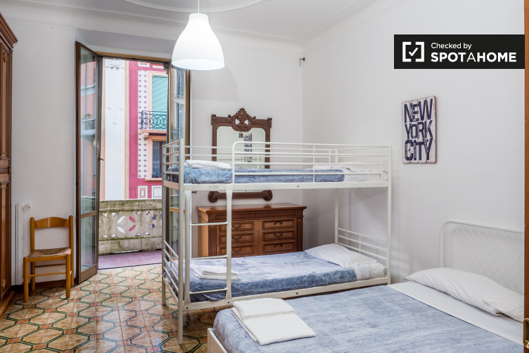 Bedroom 2 with double bed, bunk bed, and balcony