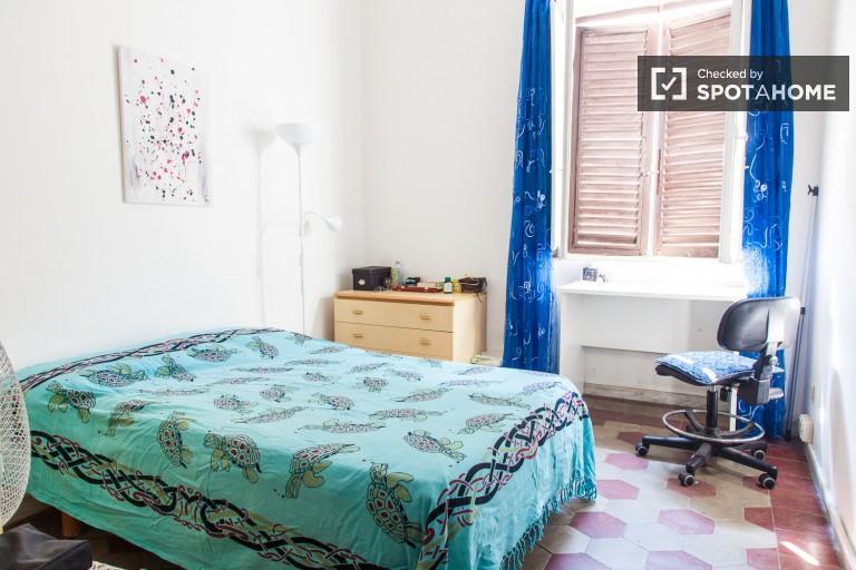 Stanza luminosa in appartamento condiviso a Termini