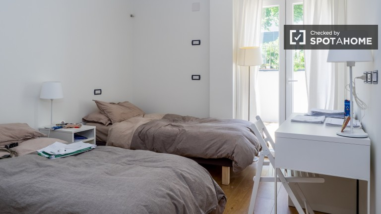 Bedroom 2 with twin beds and terrace access