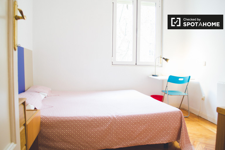 Bright room in 4-bedroom apartment in Chamberí, Madrid