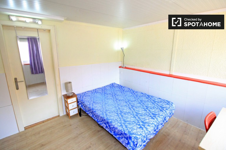 Bedroom 3 with double bed, en-suite bathroom, and balcony