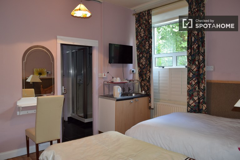 Bedroom 16 with double and single beds in shared occupancy room