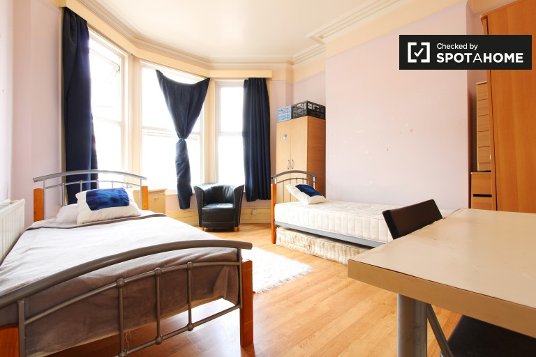 Bedroom 3, couple-friendly with 2 single beds