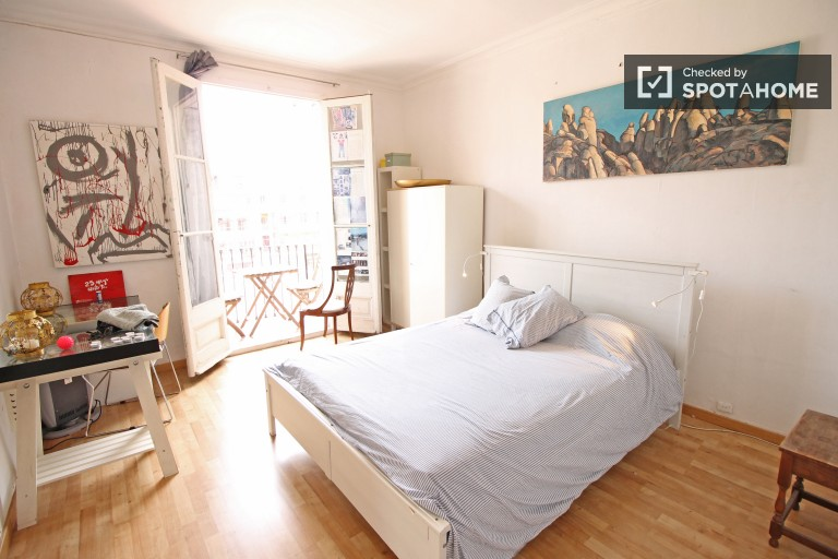 Bedroom 1 with double bed and private balcony