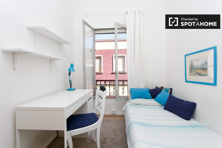 Bedroom 2 with single bed and street views