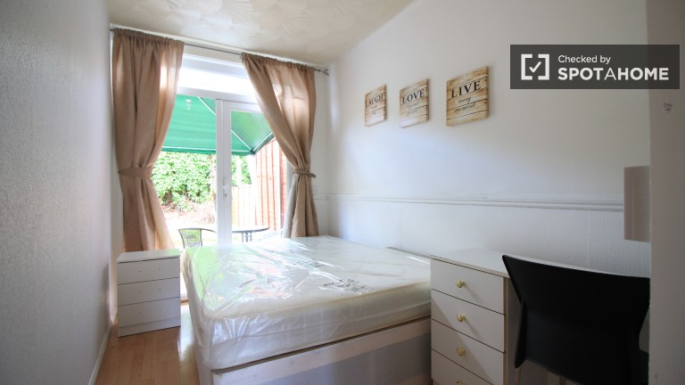 Bedroom 1 with double bed and garden access