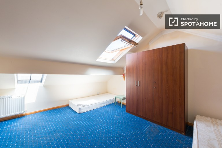 Bedroom 6, couple-friendly with double bed, single bed, and a private shower