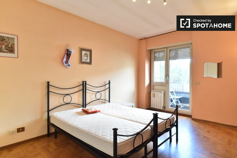 Twin Beds in Spacious rooms for rent in 3-bedroom apartment with multiple balconies in EUR Spinaceto