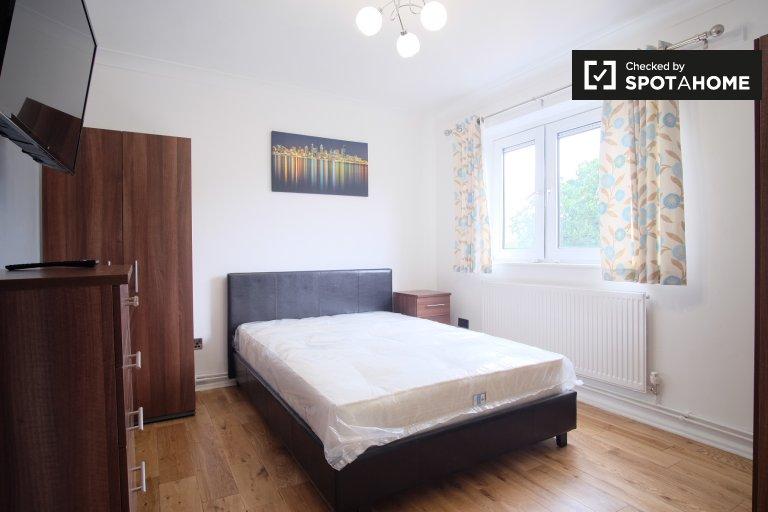 Quarto espaçoso para alugar em apartamento de 5 quartos em Wimbledon, Londres